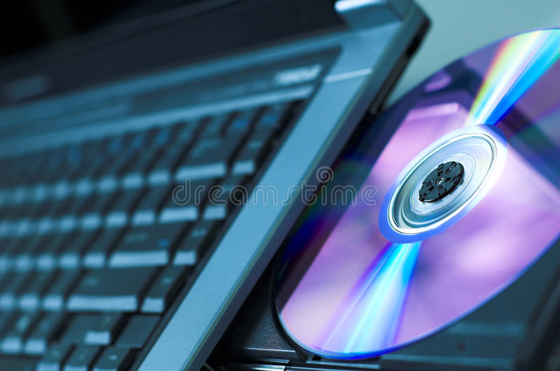 DVD-ROM. Opened laptop DVD-rom. Shallow depth of field royalty free stock images