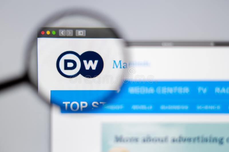 DW logo visible  through a magnifying glass. royalty free stock photo