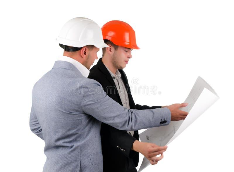 Dwa architekta dyskutuje budynku plan obrazy royalty free