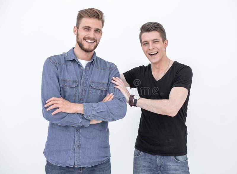 Dwa atrakcyjnego młodego człowieka odizolowywającego na białym tle zdjęcia stock