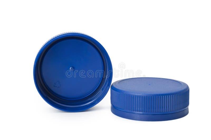 Dwa błękitów butelki plastikowa nakrętka odizolowywająca na białym tle obrazy stock