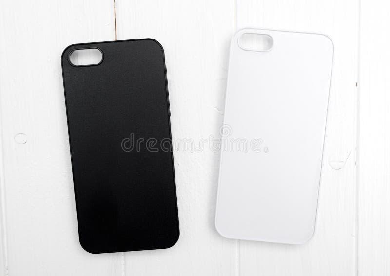 Dwa czarny i biały iphone skrzynki, topview obrazy stock