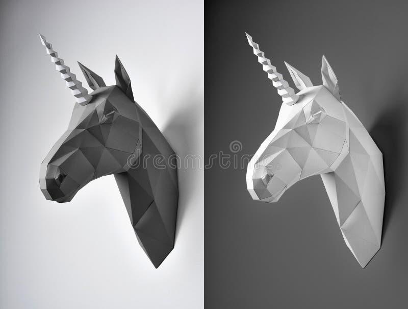 Dwa czarny i biały jednorożec głowy na kontrasta tle zdjęcia royalty free