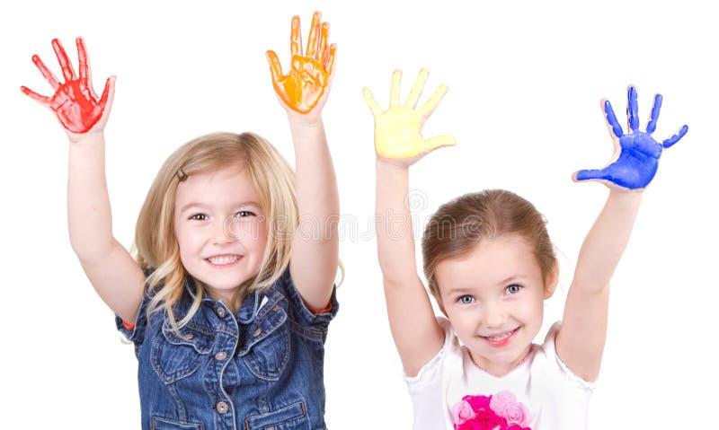 Dwa dziewczyny z farbą na rękach obraz stock