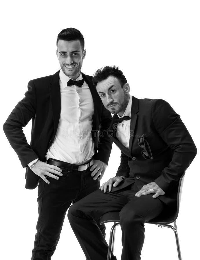 Dwa eleganckiego mężczyzna w kostiumu i bowtie zdjęcia royalty free