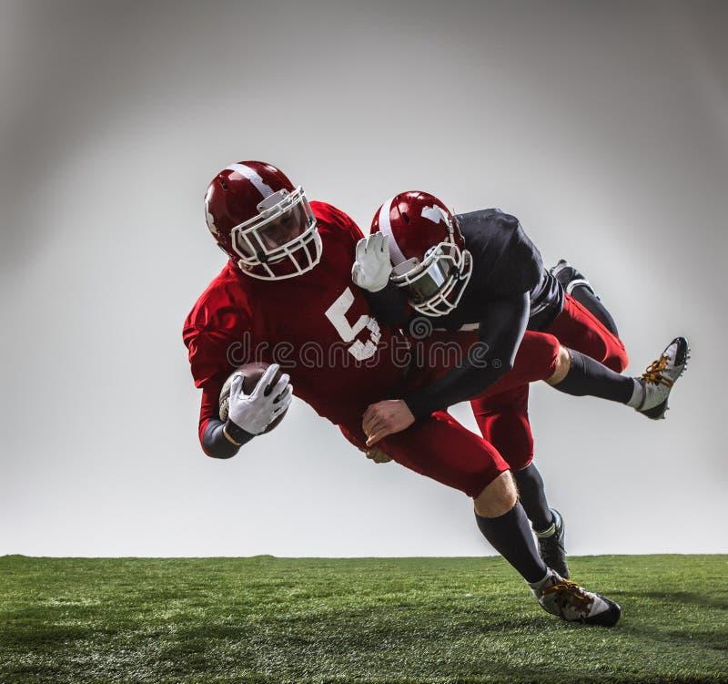 Dwa futbolu amerykańskiego gracza w akci fotografia royalty free