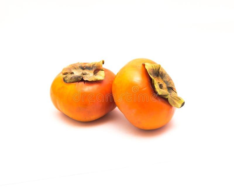 Dwa Fuyu persimmon odizolowywający fotografia royalty free