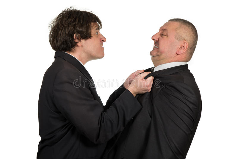 Dwa gniewnego biznesowego kolegi podczas argumenta, odizolowywającego na białym tle zdjęcia royalty free