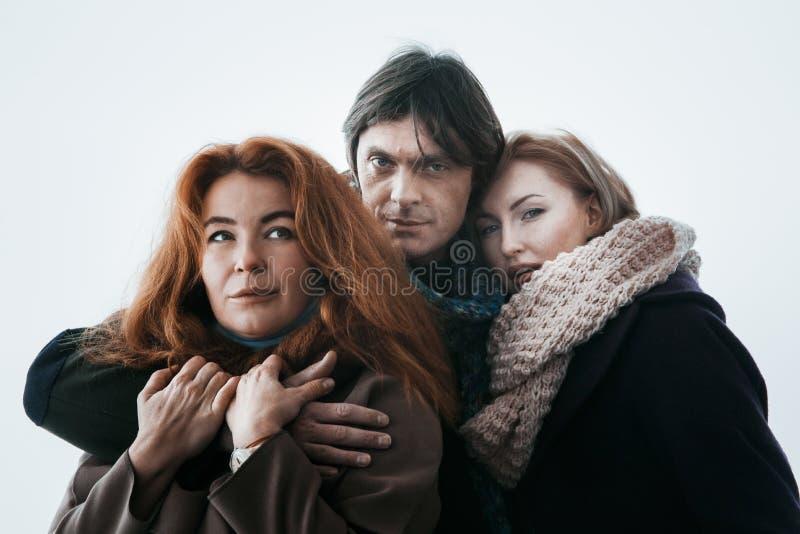 Dwa kobiety i mężczyzna Dzień, plenerowy fotografia stock