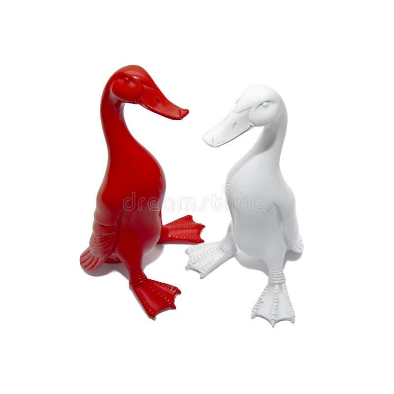 Dwa kolorowej gąski rzeźby na białym tle zdjęcie royalty free