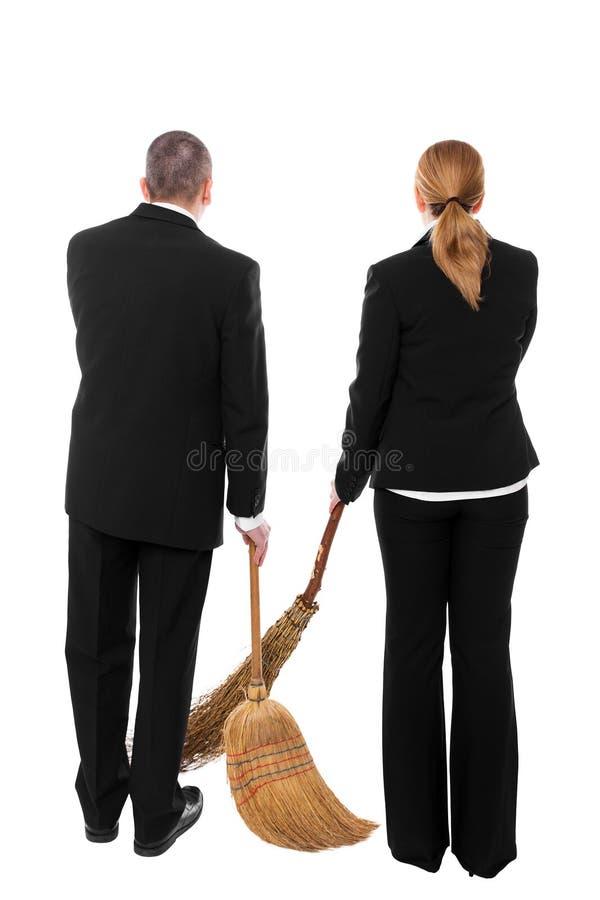 Dwa ludzie biznesu z miotłami obrazy royalty free
