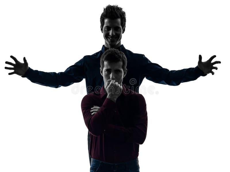 Dwa mężczyzna brat bliźniak przyjaciół dominaci schyzophrenia pojęcie s zdjęcia royalty free