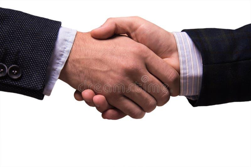 Dwa mężczyzna trząść ręki w kostiumach obraz royalty free