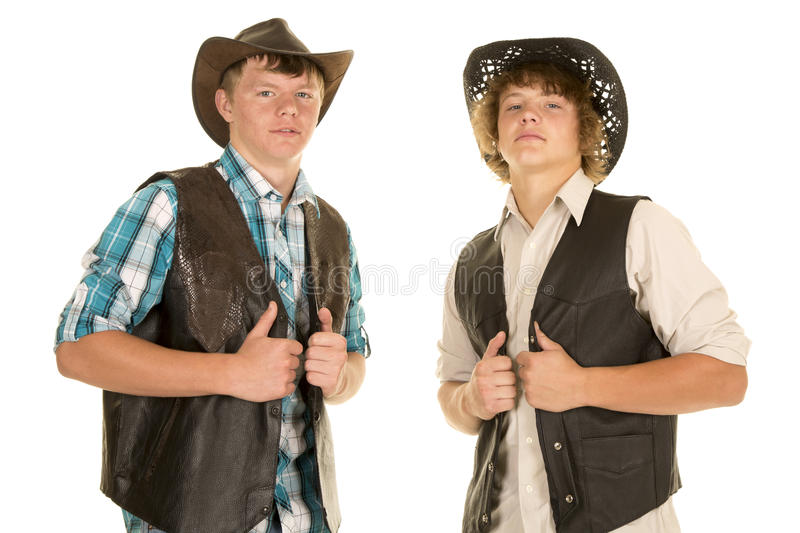 Dwa młodej kowboja chwyta kamizelki fotografia stock