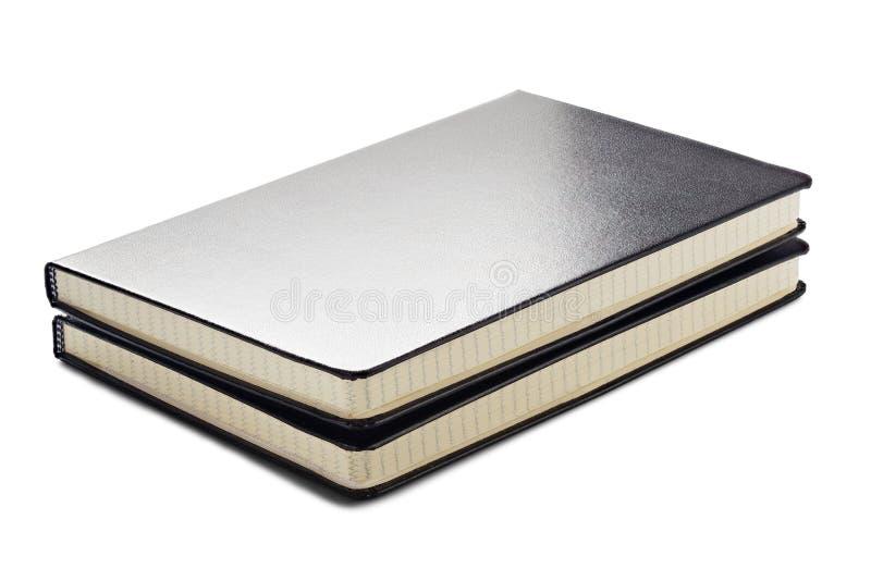 Dwa notepad, dzienniczek, czasopismo, dzień książka w czarnym kolorze na odosobnionym białym tle z cieniami zdjęcie royalty free