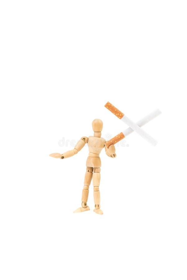 Dwa papierosu w krzyż formy mieniu drewnianą mężczyzna postacią, ` dymienia ` skwitowany pojęcie zdjęcia stock