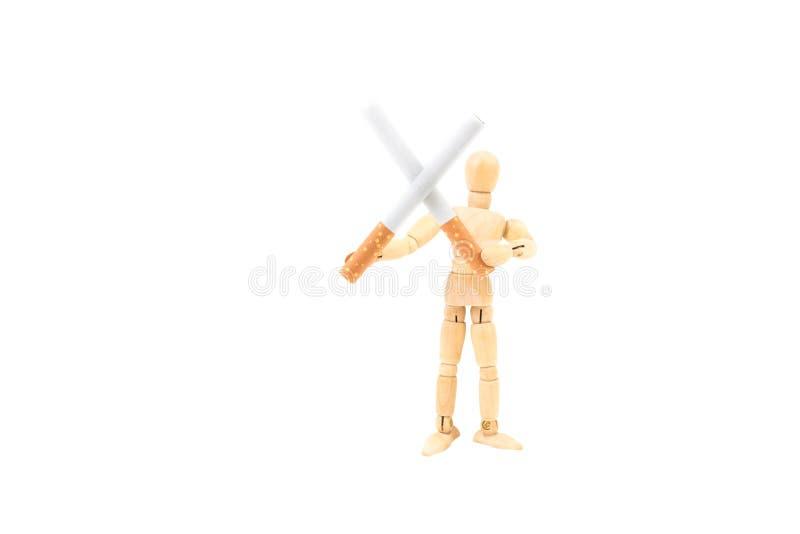 Dwa papierosu w krzyż formy mieniu drewnianą mężczyzna postacią, ` dymienia ` skwitowany pojęcie fotografia stock