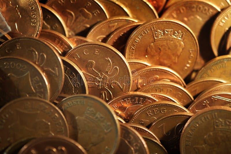 Dwa pens monety w rozrywkowej maszynie zdjęcia stock