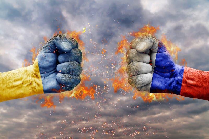 Dwa pięść z flaga Rosja i Ukraina stawiał czoło przy each inny zdjęcie stock