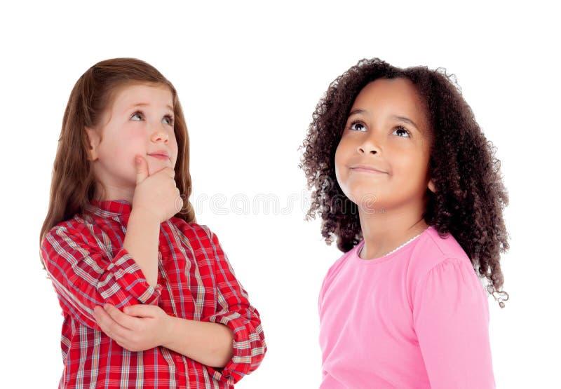 Dwa pięknych dzieci myśleć zdjęcia stock