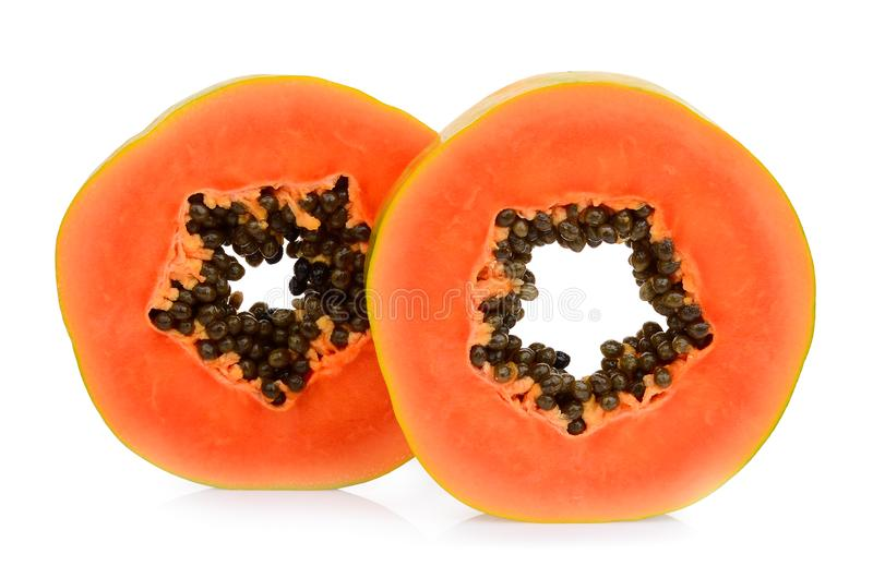 Dwa połówek cięcie dojrzała melonowiec owoc z ziarnami odizolowywającymi na bielu fotografia royalty free
