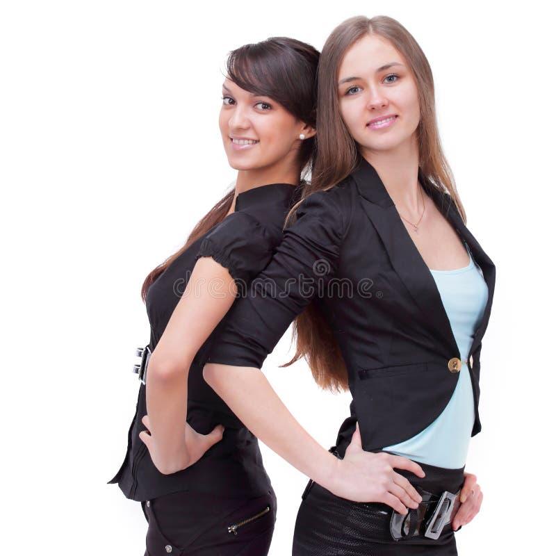 Dwa pomyślnej biznesowej kobiety trwanie z powrotem popierać zdjęcia royalty free