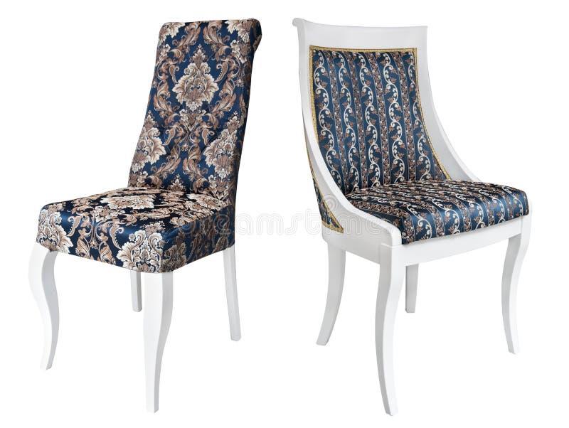 Dwa rocznika białego drewnianego krzesła z błękitnym i złocistym tapicerowaniem zdjęcie royalty free