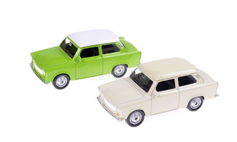 Dwa samochodu zabawki Retro zieleń i biel w 60s stylu odizolowywającym zdjęcia stock