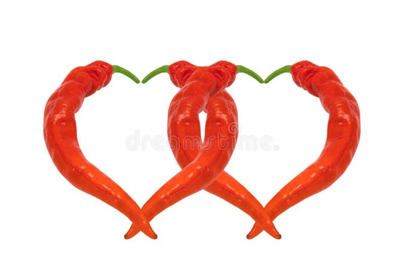 Dwa serca komponującego czerwonego chili pieprze zdjęcia royalty free