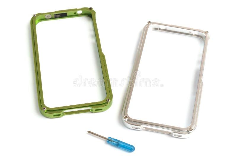 Dwa smartphone obręcza pokrywy skrzynki z usuwalnym narzędziem zdjęcia stock