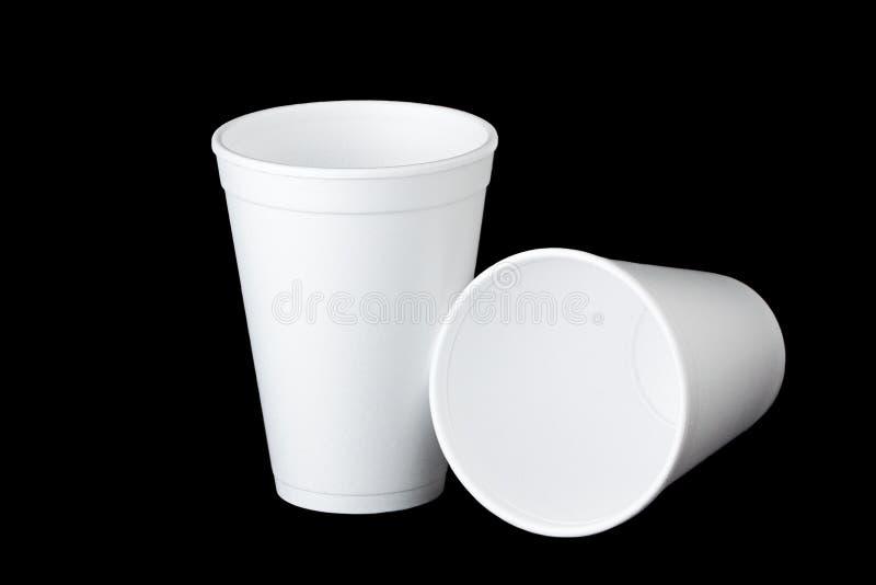Dwa styrofoam filiżanki na czerni zdjęcia royalty free