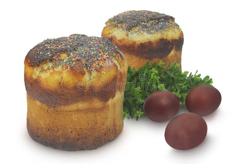 Dwa torty, jajka i mirtu odizolowywający na białym tle Wielkanocnych, zdjęcia royalty free