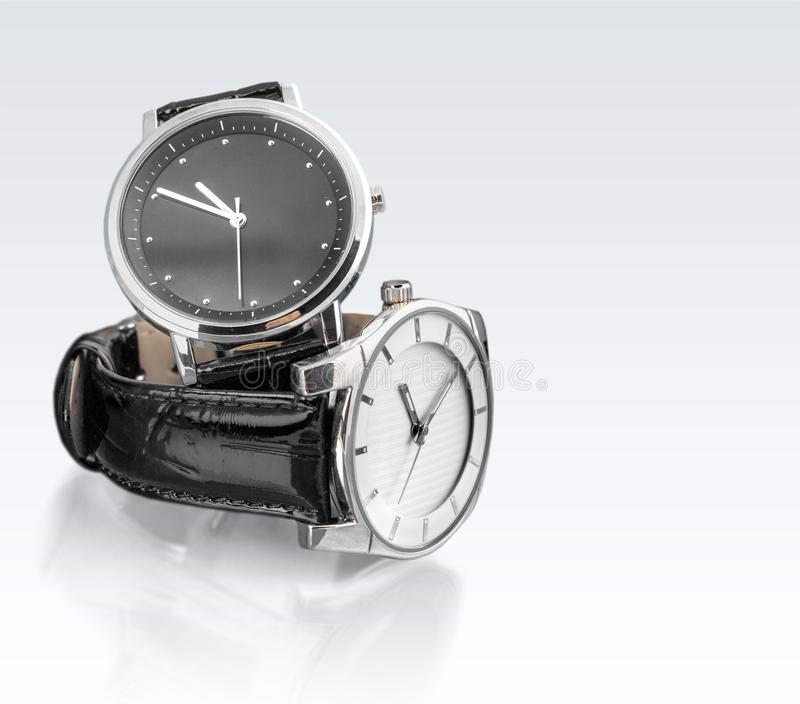 Dwa wristwatches na bielu stole fotografia royalty free