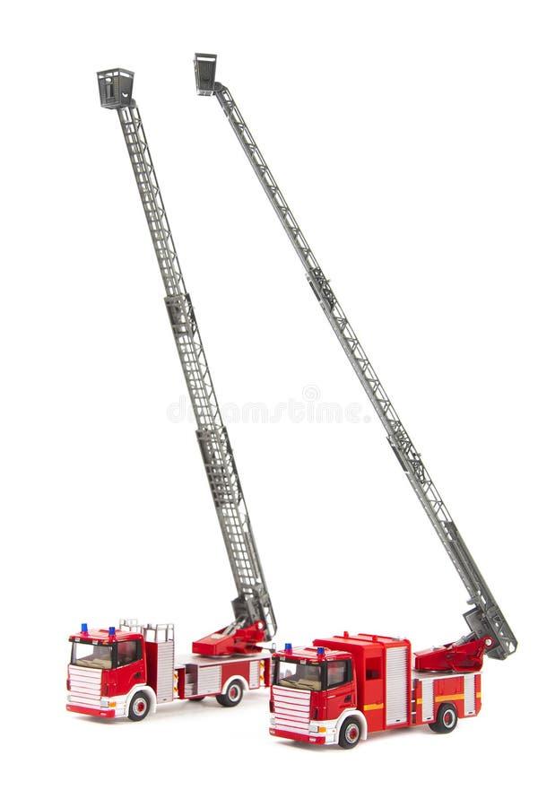 Dwa zabawkarskiej firetrucks dowcipu drabiny zdjęcia stock