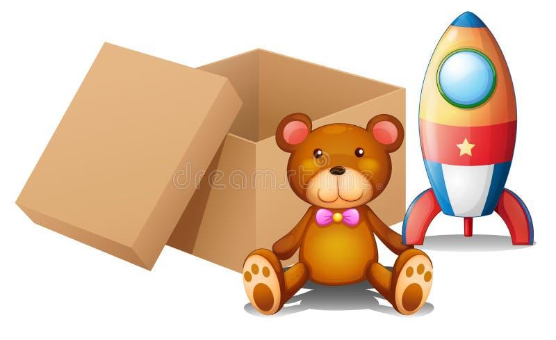 Dwa zabawki obok pudełka royalty ilustracja