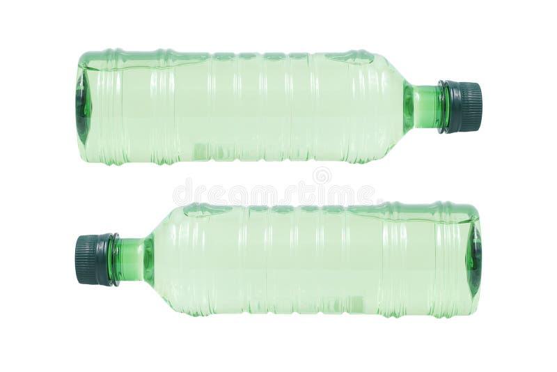 Dwa zielonej klingeryt butelki odizolowywającej na bielu obraz royalty free
