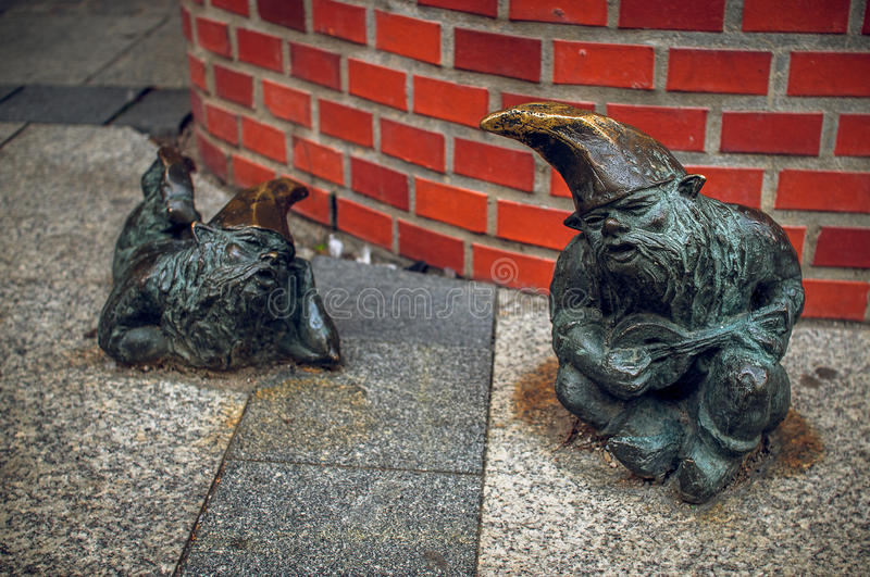 Dwarf Grajek and Meloman Wroclaw. Symbol of Wroclaw, brass dwarf. There are more than 230 in the city and still they come royalty free stock image