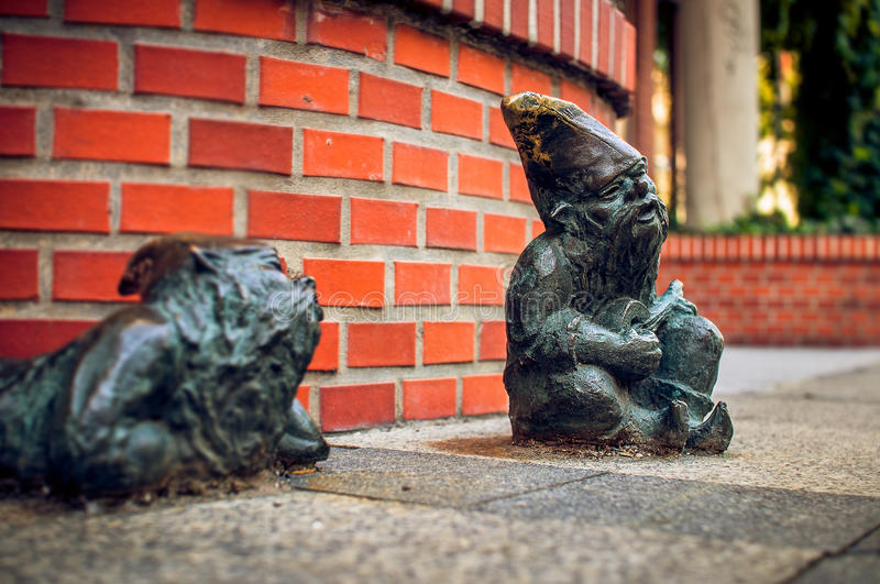 Dwarf Grajek and Meloman Wroclaw. Symbol of Wroclaw, brass dwarf. There are more than 230 in the city and still they come stock photo