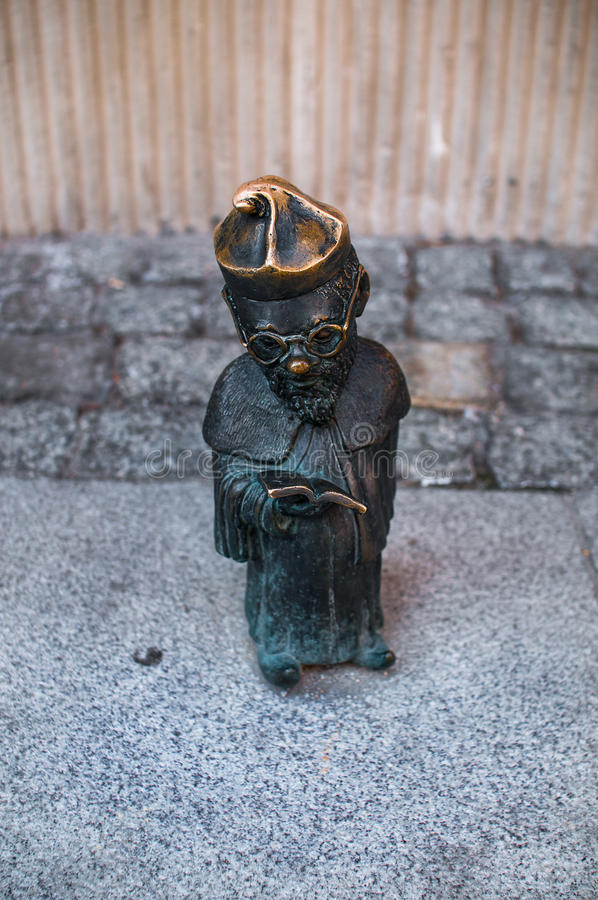 Dwarf Profesorek Wroclaw. Symbol of Wroclaw, brass dwarf. There are more than 230 in the city and still they come royalty free stock photo