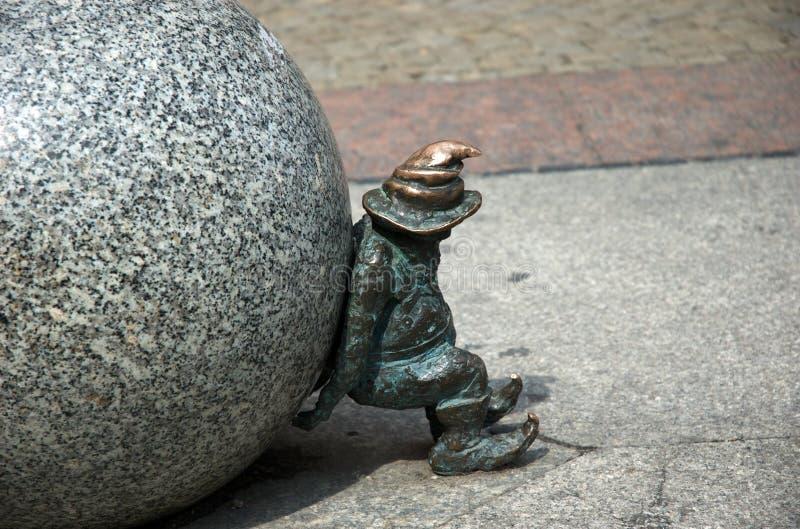 Dwarf pulling ball Wroclaw, Poland stock photography