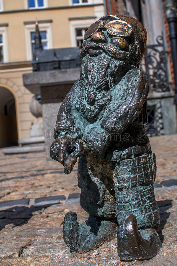 Dwarf Slepak Wroclaw. Symbol of Wroclaw, brass dwarf. There are more than 230 in the city and still they come stock images