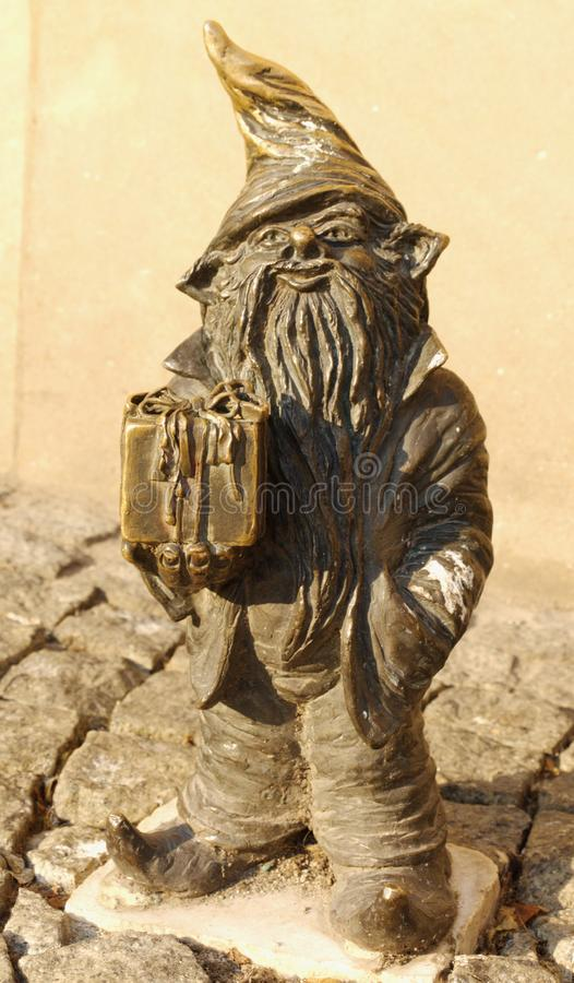 Dwarf Souvenir, very fond of little children. Especially when it presents souvenirs royalty free stock photography