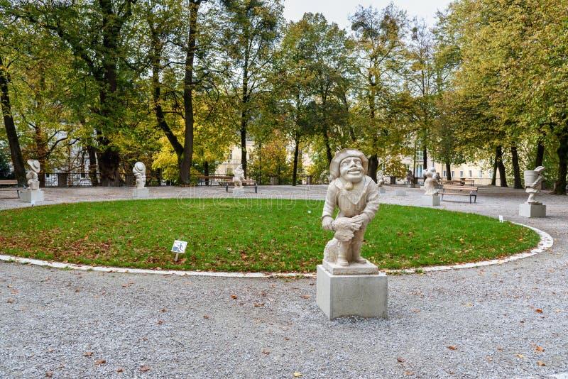 Dwarf statues in Dwarf Garden. Mirabellgarten or Mirabell garden is garden of Mirabell Palace in Salzburg. Austria royalty free stock image