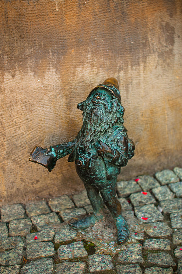 Dwarf Turysta, Wroclaw. Symbol of Wroclaw, brass dwarf. There are more than 230 in the city and still they come stock photo