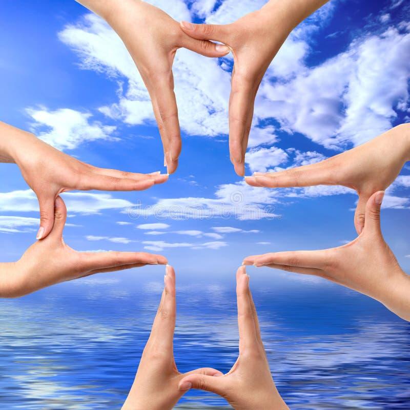 Dwars Symbool dat van Handen wordt gemaakt stock afbeeldingen