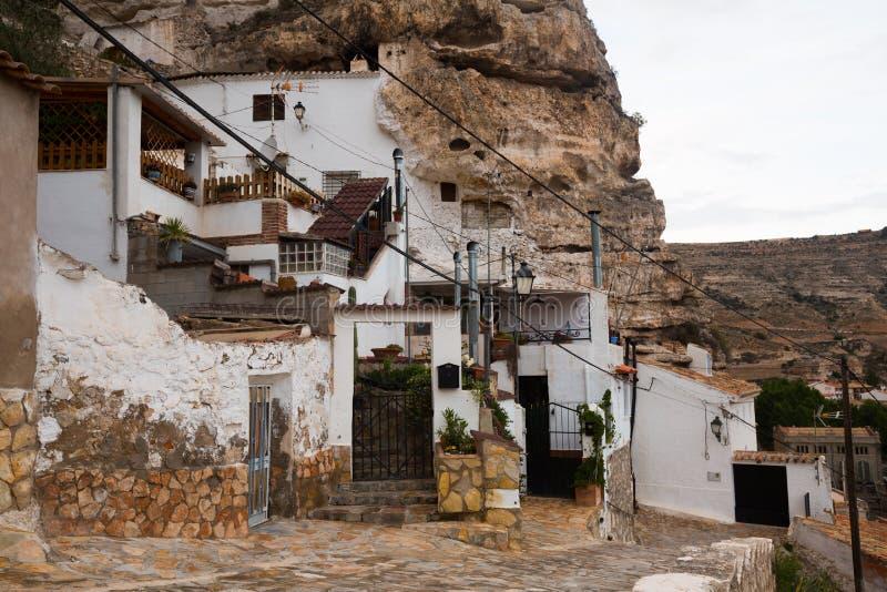 Dwelling houses built into rock. Alcala del Jucar. Province of Albacete, Castile-La Mancha, Spain royalty free stock photos