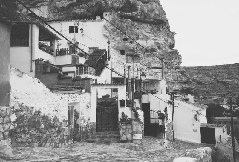 Dwelling houses built into rock. Alcala del Jucar. Province of Albacete, Castile-La Mancha, Spain stock photo