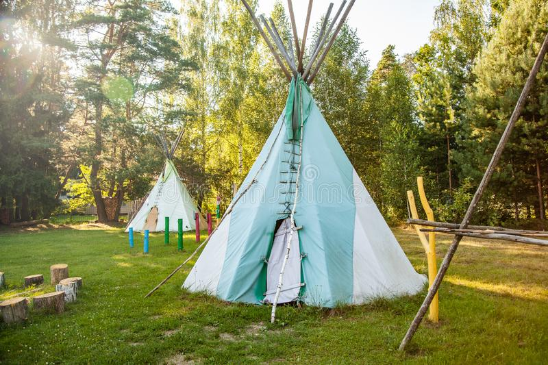 Dwelling tipi, The wigwam in the forest royalty free stock photography