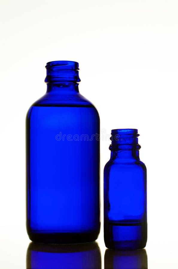 dwie butelki niebieski obraz stock