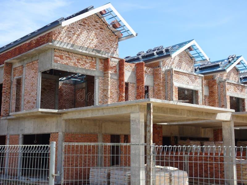 Dwoisty opowie?? luksusu tarasu dom w budowie w Malezja zdjęcia stock